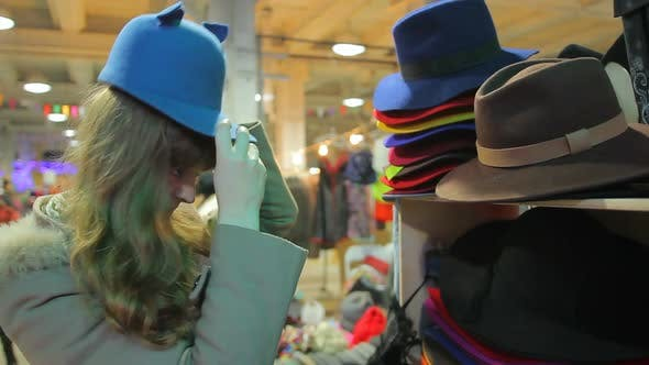 Thumbnail for Female Customer Putting Cute Funny Hat On, Having Fun in Department Store