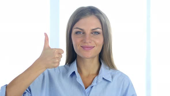 Thumbnail for Portrait of Positive Young Woman Gesturing Thumbs Up