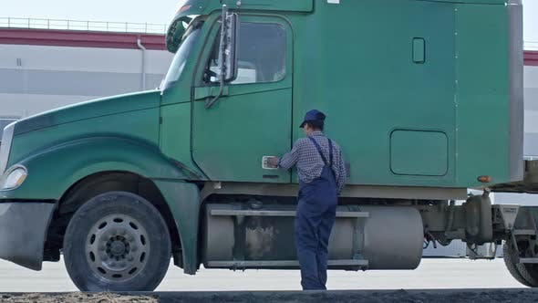 Thumbnail for Female African Driver Getting into Semi-Truck