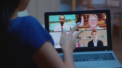 Freelancer Having Video Conference with Team