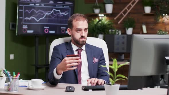 Thumbnail for Caucasian Male Corporate Worker Enters Credit Card Information in the Computer