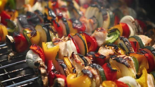 Overcooked and Burned Shashliks on Hot Barbecue Grill