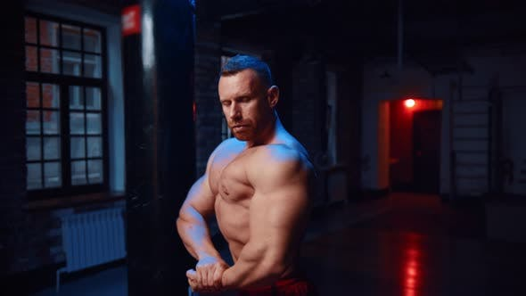 Thumbnail for Strong Man Standing in the Gym and Showing His Big Muscles