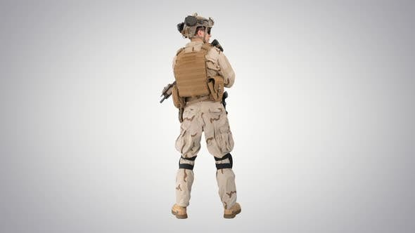 Fully Equipped Solder Holding Assault Rifle and Standing Looking To the Sides on Gradient Background