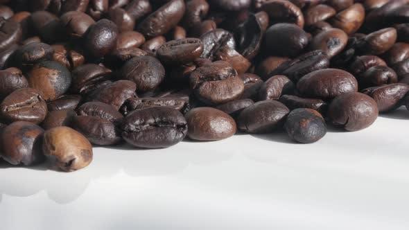 Thumbnail for Arabica coffee beans on white 4K slow tilt footage