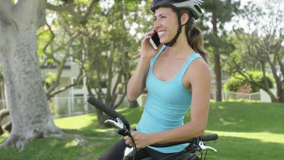 Thumbnail for Woman cyclist talking on phone