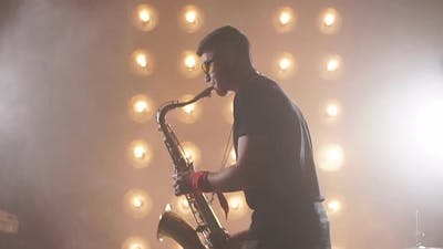 Musician Holding a Saxophone