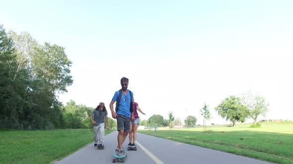 Thumbnail for Man riding longboard with friends