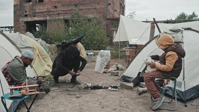 Refugees Charging Mobile Phones at Tent City
