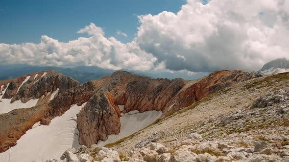 Thumbnail for Wonderful View of Brown and Gray Snow Mountains in Caucasus Under Large Flying Clouds in the Summer