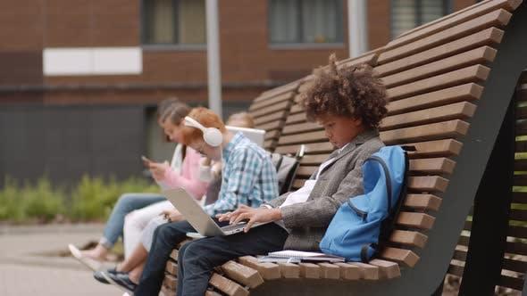 Thumbnail for Diverse Pupils Using Gadgets during Break