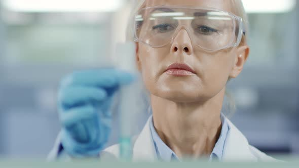 Cover Image for Female Chemist Carrying out Scientific Experiment