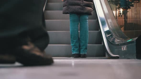 Thumbnail for Legs of People Moving on an Escalator Lift in the Mall. Shopper's Feet on Escalator in Shopping