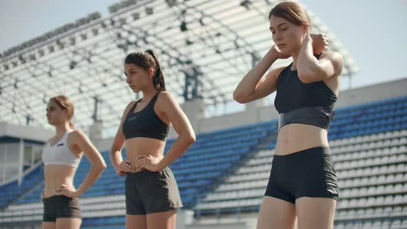 Thumbnail for Side View of a Group Female Athlete Starting Her Sprint on a Running Track. Runner Taking Off From
