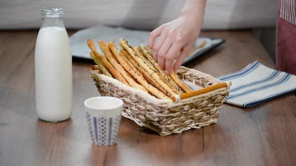 Thumbnail for Grissini Breadsticks, Sesame-Covered Bread Sticks. Fresh bread sticks in a basket.