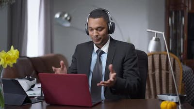 Concentrated Professional Manager Working in Home Office Online