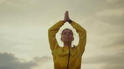 Yoga Trainer Meditating in Tree Pose