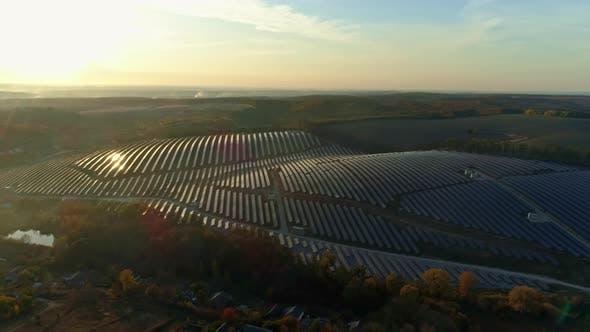 Thumbnail for Aerial Drone Footage. Backward Flight Over Solar Panel Farm at Sunset Autumn Season.