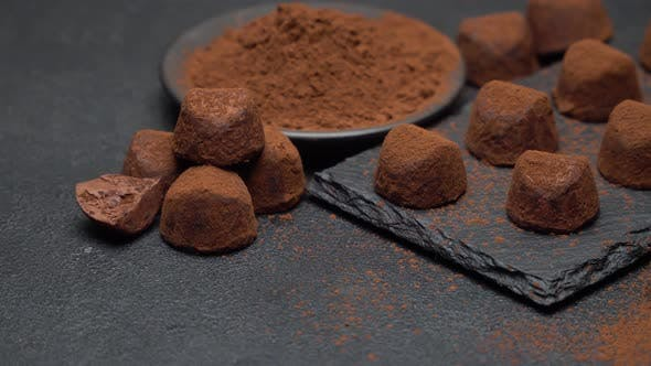 Thumbnail for Classic Chocolate Truffles on Dark Concrete Background