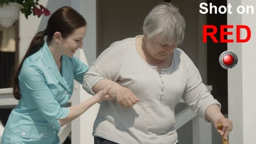 Nursing Home Helping To Walk