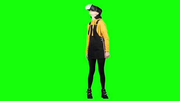 Thumbnail for Teenager Looks Into Virtual Reality Glasses. Green Screen