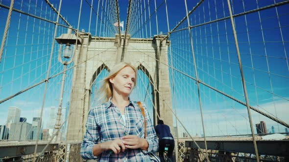 Thumbnail for Attractive Woman Walks on the Brooklyn Bridge on a Clear Summer Day