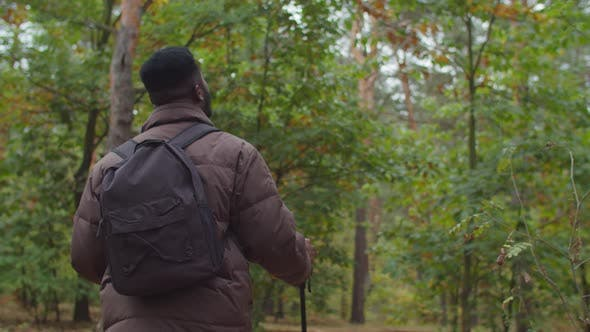 Thumbnail for African Hiker with Backpack Travelling in Forest