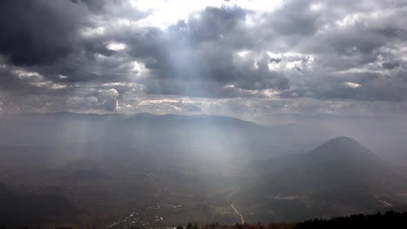 View of the Sunbeams in Plain From Top of The Mountain