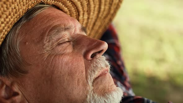 Thumbnail for Senior man relaxation in hammock. Shot with RED helium camera in 8K.