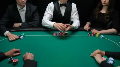 Professional Casino Dealer Shuffling and Distributing Playing Cards, Poker Game