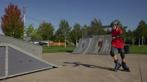 Boy Rollerblading at park