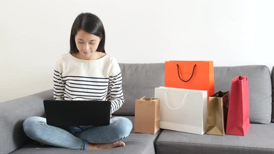 Thumbnail for Woman using laptop computer for online shopping
