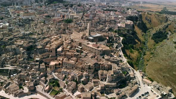 Aerial View of Ancient Town of Matera Circling Around City, Italy