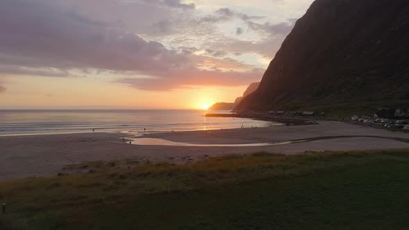 Thumbnail for Aerial View of Night Surfers and the Sunset Behind the Mountain