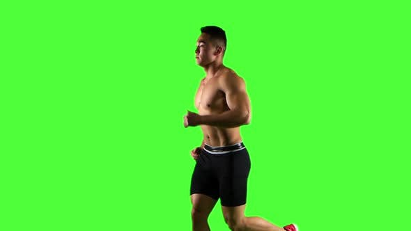 Thumbnail for Man Running on Green Screen Background, Slow Motion. Side View