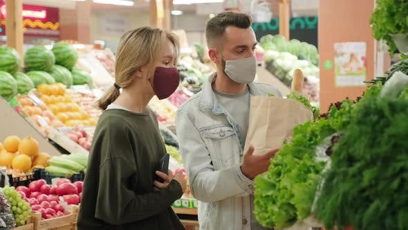 Thumbnail for Couple in Face Masks Shopping at Market during Pandemic