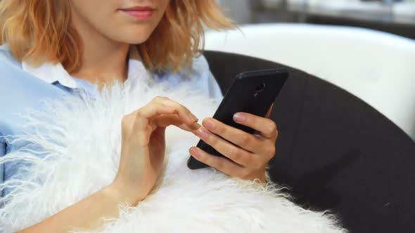 Thumbnail for The Girl Is Texting in Her Mobile Phone