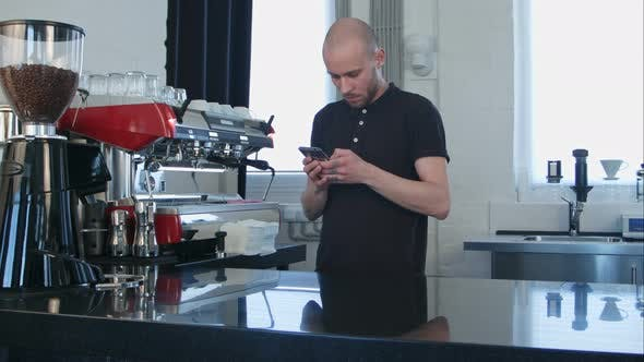 Thumbnail for Male Barista Using Smartphone at Work Place