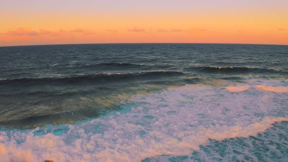 Thumbnail for Powerful Wave Breaks Along the Shore at Beautiful Sunset Time