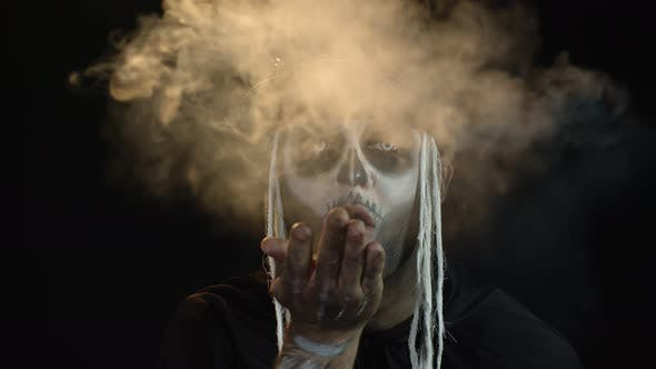 Thumbnail for Sinister Man with Horrible Halloween Skeleton Makeup Making Fly Air Kiss with Smoke. Day of The Dead