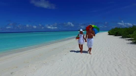 Young people on romantic honeymoon have fun on beach on paradise white sand 4K background