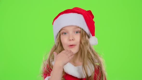 Thumbnail for Baby Girl in Red Christmas Caps Send Air Kisses. Green Screen