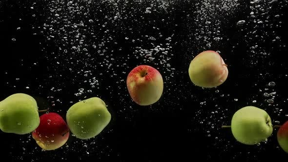 Thumbnail for Fresh Fruits Colorful Apples Falling Into Water with Splash and Bubbles Black Background