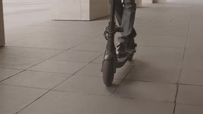 Unrecognizable Person Riding E Scooter