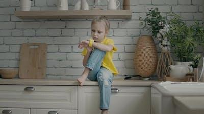 Blonde girl using her smart watch