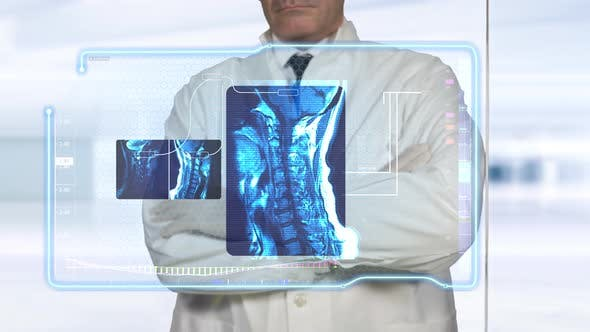 Doctor Diagnosing Virtual X-Ray Scans of Neck Bones and Skeletal Tissues