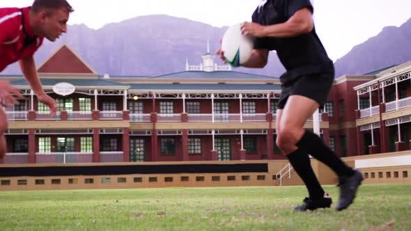 Thumbnail for Male rugby players playing rugby in the stadium 4k