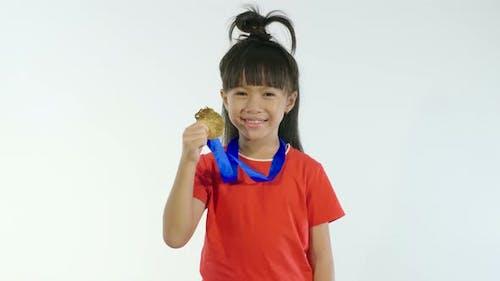 Little Girl Holding Golden Medal
