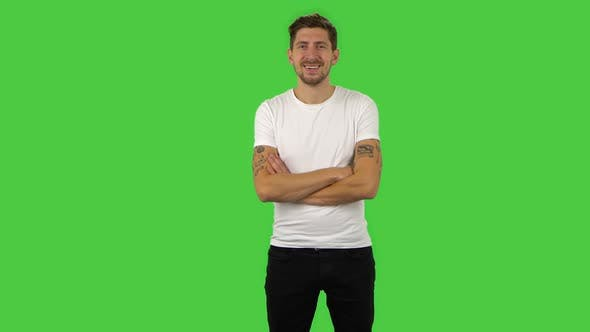 Thumbnail for Confident Guy Is Looking Straight, Crossing His Arms Over His Chest and Nodding His Head. Green