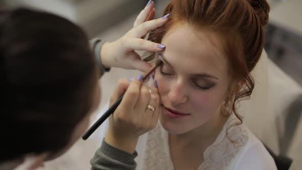 Wedding Makeup Artist Making a Make Up for Bride in Veil